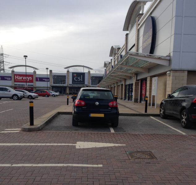 This Volkswagon has been left stradling two parking bays