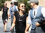 The smile that says IÂ¿m in love! Britney Spears beams as she holds hands with her 'everyday Dave'