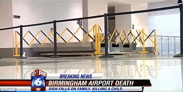 Crushed: The giant flight status sign, estimated to weigh between 300-400 pounds, is seen resting on the ground of the brand new terminal that was just opened last week