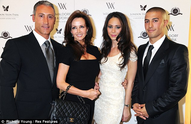 Andreas has tried to ensure that his family remain grounded. pictured with wife Susan , Elena Pantelli and his son George Panayiotou