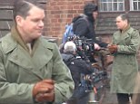 Feeling cold, comrade? Matt Damon wraps up in a Russian uniform on the set of his latest film