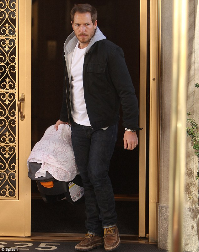 All aboard! Daddy Will carried baby Olive along for their Manhattan adventure