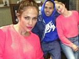 Making music together: Jennifer Lopez rests her head on Chris Brown's shoulder for studio Twitter picture