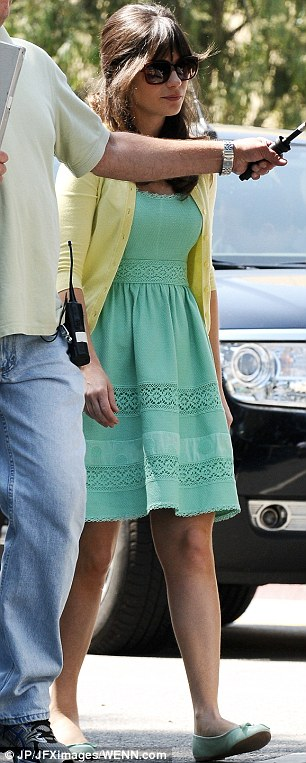 Pretty in pastel: The actress' hair shone in the sunlight as she protected herself from the rays with sunglasses, an umbrella and a cardigan