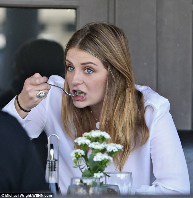 She's got bite! Mischa Barton celebrated her latest role in A Resurrection over a hearty lunch with friends at Via Alloro in Beverly Hills Friday