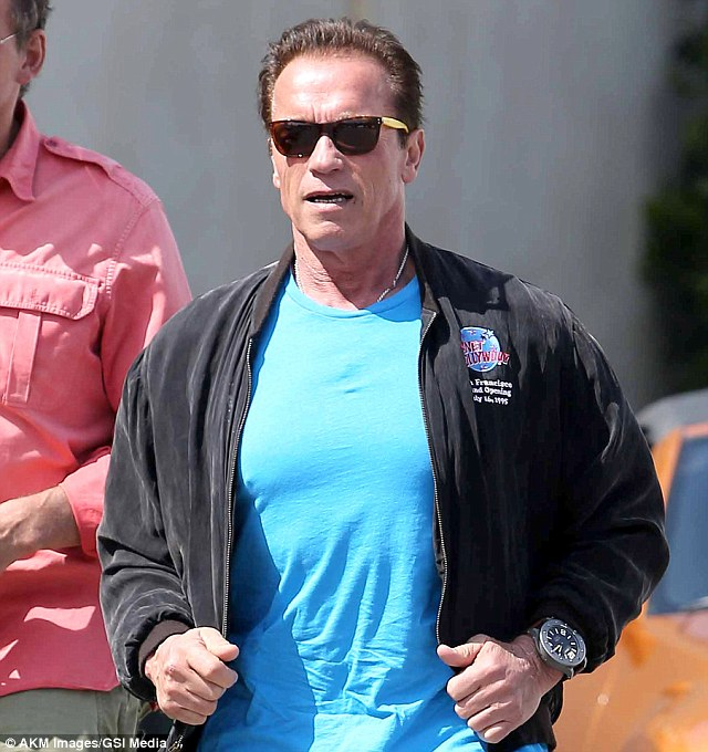 Looking good: Arnold appeared to enjoy the warm day