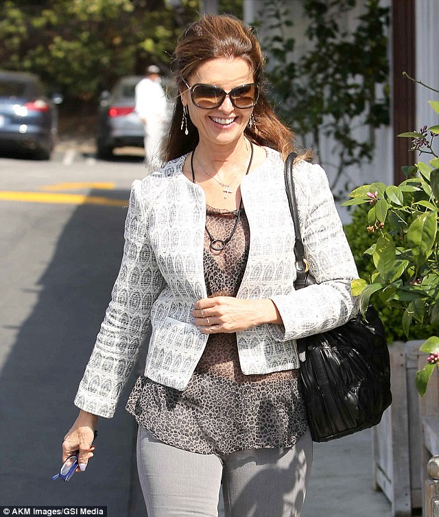 Happy lady: Maria was the picture of dressed down elegance on the warm sun-filled day