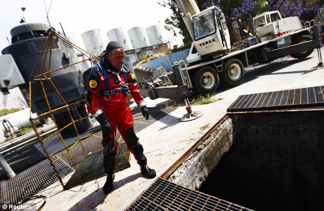 Cu Camara, who started working as a sewer diver 30 years ago, uses a diving suit and helmet that weigh more than 40kg to protect him during his dives