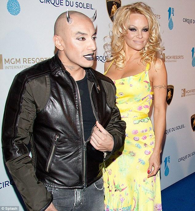 Horror show: Pamela Anderson was escorted down the carpet by eccentric actor Jesus Villa