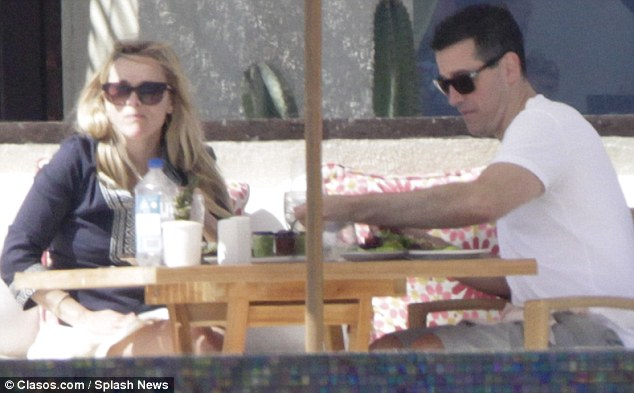 Birthday lunch: Reese enjoyed a sun soaked meal with her husband to mark her big day