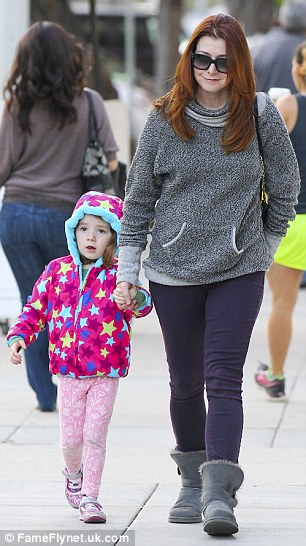 Hot chocolate? The How I Met Your Mother star clutched the expressive little girl's hand as they window shopped, eventually ending up at a coffee shop