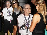 Getting some much needed tips? Paris Hilton meets 'oldest DJ in the world' Ziggy 420 as she attends Ultra Music Festival