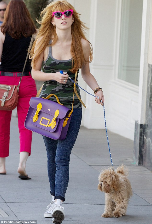 Afternoon stroll: Bella's hair blew in the wind while neon pink sunglasses shaded her eyes from the Beverly Hills sunshine