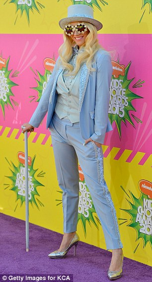 I'm still standing: The embellished powder-blue tuxedo, hat, and cane were a refreshing change from the Tik Tok singer's typical hard-partying, scantily-clad persona