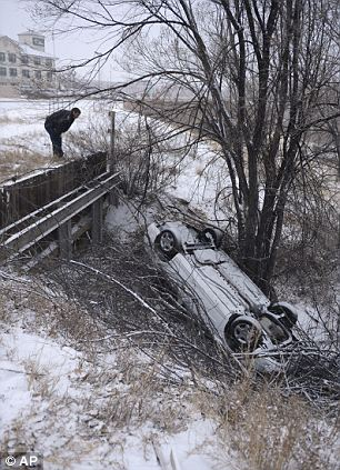The scene of a one car in Colorado Springs, Colo. early Saturday morning, March 23, 2013. The driver of the vehicle escaped serious injury