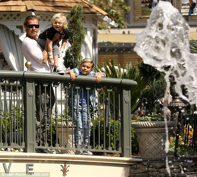 Check it out: Bush rocker Gavin showed his sons the water fountain at the shopping centre