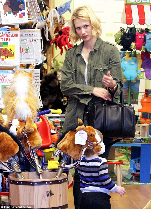 Anything for her little boy! January Jones decided to treat her son Xander Dane with a new toy at a shop in Larchmont Village Saturday