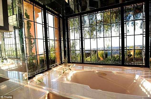 Bathtime views: Larry was even able to enjoy the spectacular panoramas even when he was enjoying a soak