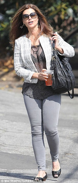 Sheer daring: Maria walked along in her see-through top as she headed to Brentwood Country Mart