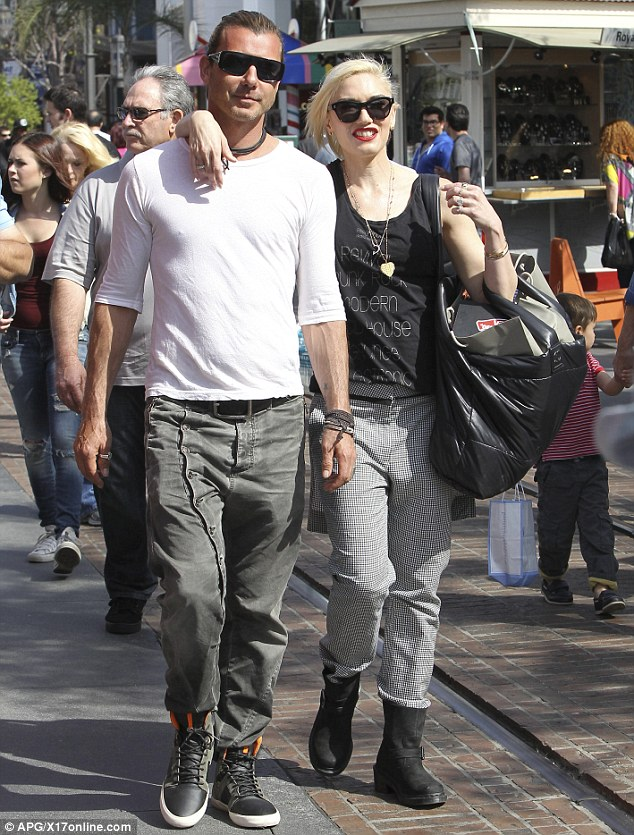 So in love: The longtime rock couple shared a tender moment on their sunny stroll through the outdoor mall