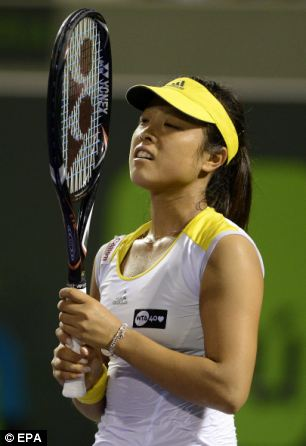 Ayumi Morita of Japan reacts to losing a point against Serena Williams