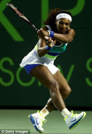 Serena Williams returns a shot to Ayumi Morita