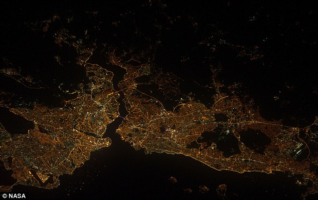 Sparkling: A nighttime view of Istanbul, Turkey with the Bosporus strait separating the two halves of the city