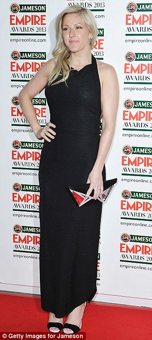 Playing it safe: Ellie opted for a black frock for the evening, flashing some flesh on her back