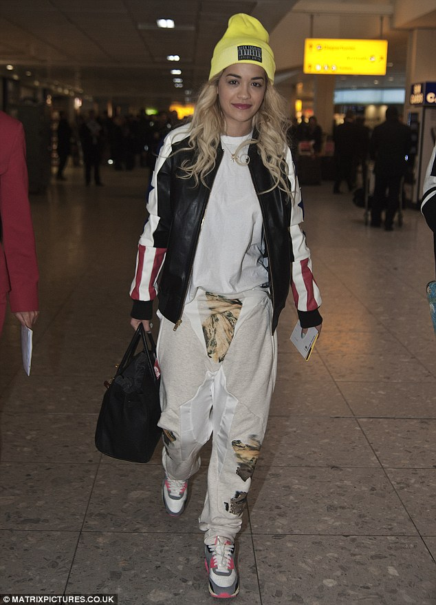 Different style: Rita looked a far cry from her glamorous on-stage image when she flew out to the party the day before