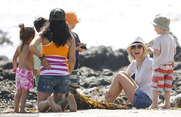 Hanging loose: Naomi relaxed on the sand with her mini-me son Sammy