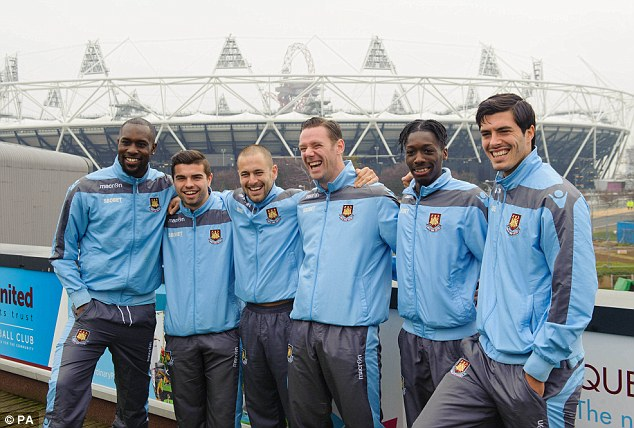 Happy Hammers: West Ham players pose outside the Olympic Stadium