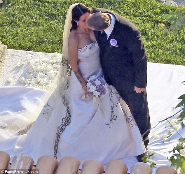 Newlyweds: Sandra's ex Jesse James married Alexis DeJoria on Sunday in Malibu, California