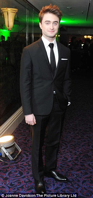 Suited and booted: Daniel Radcliffe and Martin Freeman wore very different get-ups to watch the awards unwind