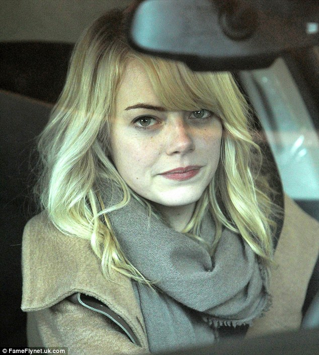 Natural beauty: Emma Stone showed off her flawless complexion as she stepped out make-up free on Sunday while leaving her hotel in Boston, Massachusetts