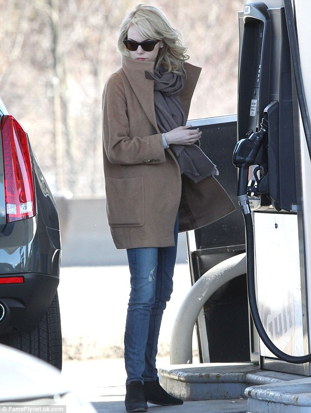 Keeping the cold at bay: Emma made sure to wrap up against the chilly winter weather, teaming an effortlessly chic camel coat with a snuggly scarf, jeans and shoe boots