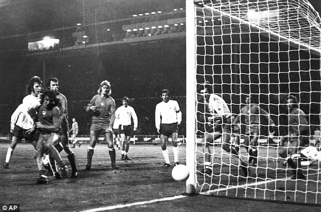 Cruel: Despite the best efforts of Mike Channon (left) this effort against the post was as close as England came to scoring from open play