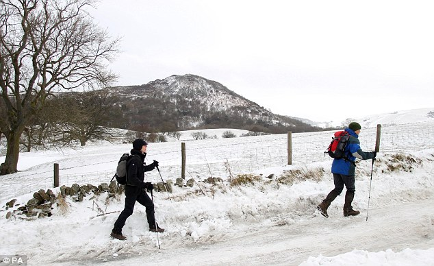 Walkers brave the snowy conditions in Sutton, Cheshire yesterday