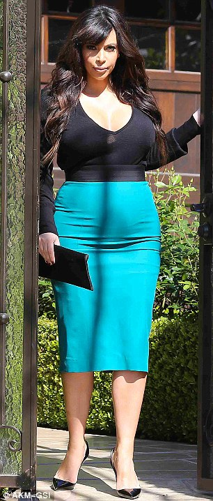 Tight and low cut: The TV star squeezed into her pencil skirt and a low-cut sheer knit for the outing