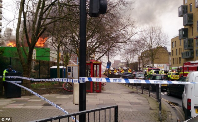 Street view: The fire was discovered around 12.30pm today and spread through the Newington Library, the Cuming museum and a Walworth council one-stop shop