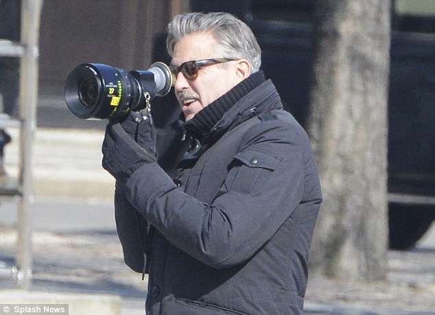 Behind the lens: George clutched onto a hand held camera to shoot some footage