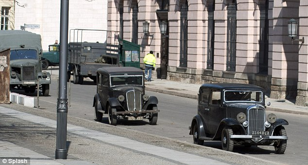 Vintage: Old vintage cars and military trucks parked on the side of the road also helped set the scene