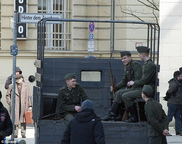 War times: Castmates dressed as soldiers sat chatting in the back of an old military truck