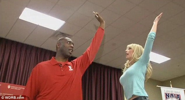 How high? Brown demonstrates the high five he claims to have invented with a WDRB reporter