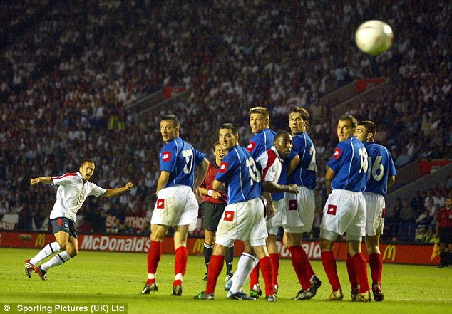 Match winner: Joe Cole curls home the decisive goal in England's 2-1 friendly win over Serbia and Montenegro back in June 2003