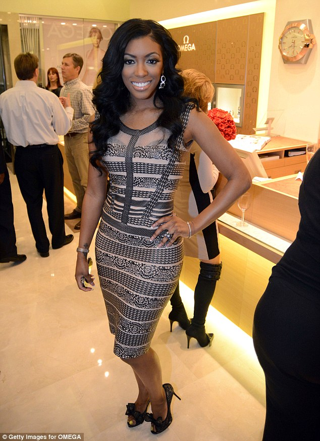 Devoted wife: Porsha, pictured in January, shot back at rumours that her husband was gay by saying, 'One thing I do [know] is my husband loves me, and he puts it down and I will be with him forever.'