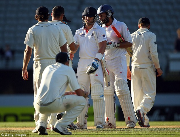 Digging in: Matt Prior and Monty Panesar (right) secured a draw n the third Test against New Zealand