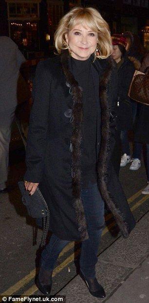 Big coat weather: Felicity Kendall and Christian Jessen kept warm in long black winter wear