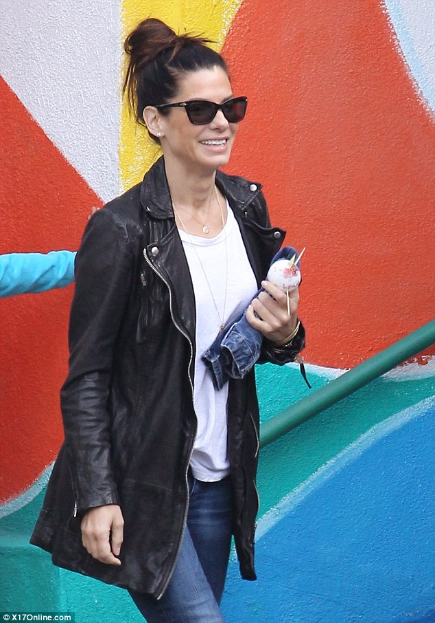 Full of smiles: Sandra Bullock looked happy after dropping her son Louis off at school in Los Angeles, California on Monday, a day after her ex Jesse James got married