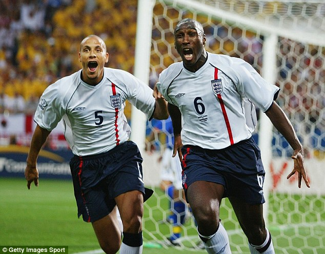 Old pals: Ferdinand and Campbell in action for England at the 2002 World Cup finals