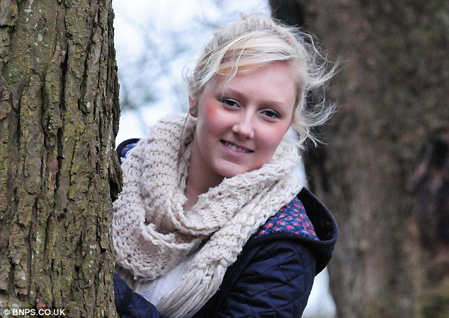 Terri Leigh Cox, 17, took a quick snap of the 'primate' shortly before it scampered up a tree and out of sight
